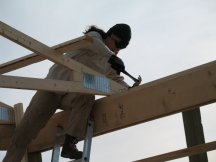 Laura secures the second truss